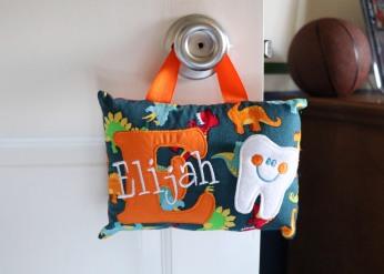 tooth fairy pillow on door.jpg